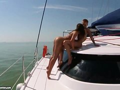 Debbie White and Sinead licking on a yacht