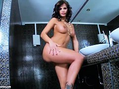 Stunning Black Angelika masturbates in bathroom